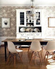 Replica Eames dining chairs with white buffet and rustic table