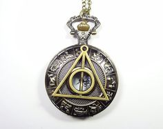 Harry potter Deathly Hallows Pocket Watch Necklace,Zodiac Pocket Watch Necklace,constellation Necklace. $5.99, via Etsy.