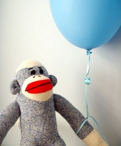 Display Jackson's sock monkey holding balloons