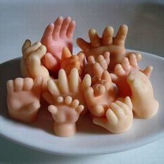 Wash your hands with Hand Soap. Soap shaped like little hands! Each hand is hand made. Isn't that handy? from Mental Floss
