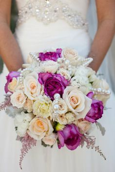 Love all the different colored roses with pearls mixed in. Elegance