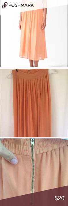 "Forever 21 pleated chiffon skirt size small Forever 21 pleated chiffon skirt- soft orange/peach.  Size small. Length 33.5"", sits high on waist, has exposed gold zipper on back. Light and breezy, perfect for summer! This is a reposh that I ended up not wearing to a wedding. Perfect condition and super cute! Forever 21 Skirts Midi"