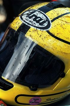 """""""A fly for every mile"""" - Joey Dunlop's iconic yellow helmet bearing the evidence of his speed"""
