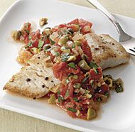 The easy-to-make sauce for this fish gets its tangy punch from items you might have on hand—canned tomatoes, olives, and capers. When prepping your ingredients, be sure to rinse the olives and capers, or they'll make the sauce too salty