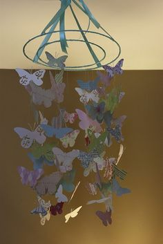 Butterfly mobile, so pretty! Updating my 7 year old's room and with a little color change, she'll LOVE THIS!