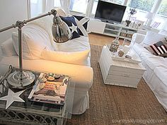 Casual white sofas, wicker accents, Ikea lamp
