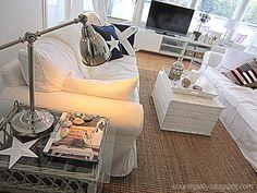 Casual white sofas, wicker accents, Ikea lamp
