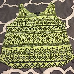 Lime green tribal tank size small This tank has never been worn! It's a size small from forever 21 and is true to size! Lime green with black tribal print :) Forever 21 Tops Tank Tops