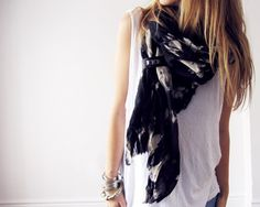 love this.. from etsy $118.00  The LASSO tie dyed cotton and leather scarf  I constantly get asked how I tie the large scarves in my photos, so I designed a scarf that essentially ties itself. Just wrap it once around your neck and then pull the opposite end through the small leather loop and - voila! - the perfect wrap!