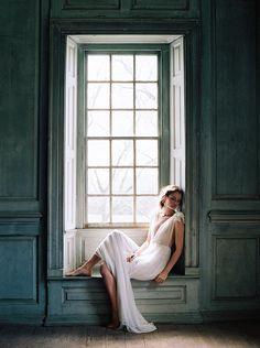 Dreamy bridal portrait near a window.