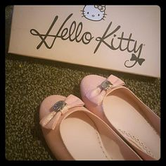 Glitter Pink Hello Shoes 8.5 Hello Kitty Slip on shoes. Pale pink with glitter. Bows on toe with Hello Kitty in silver. Very cute shoe! Never worn. Comes in original box. Sanrio Shoes Flats & Loafers