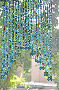 Beaded Valance Curtain for a door window or wall in Blue Turquoise Green shadows and touches of red yellow and orange – 2019 - Curtains Diy Boho Curtains, Beaded Curtains, Valance Curtains, Lace Valances, Carillons Diy, Diy Crafts, Recycled Cd Crafts, Blue Crafts, Rainbow Crafts