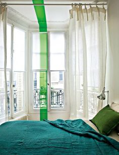Color Tip: If you are worried about being overwhelmed by color, use it in smaller doses to accent rather than dominate. For example, the green pillow, painted stripe, and teal blanket in the bedroom above are all easy to switch out if they're not working for you down the road.