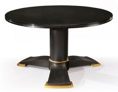 JULES LELEU & KATSU HAMANAKA - Rare low circular table in black lacquered and darkened wood with large gilded bronze finish. Numbered. Circa 1940.