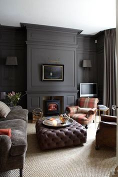 Matte charcoal walls and a tufted ottoman = heaven