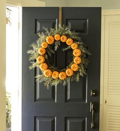 Make this pumpkin wreath for fall.