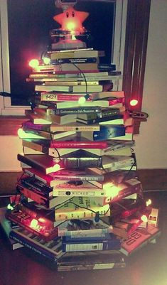 A Christmas tree of books! I certainly have enough to do this. Next year, perhaps.