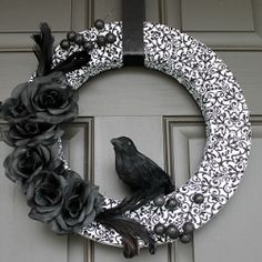 Fabric wrapped foam Halloween wreath, with raven inspired embellishment.