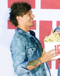 Louis Tomlinson! His smile kills me :( But it's a good kind of kill...you know? :)