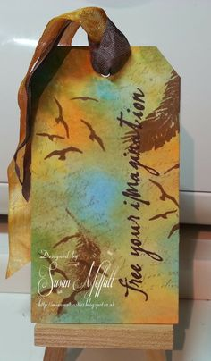 Handmade tag featuring birds in flight created by Susan Moffatt. Love the inked earthy background. #Bird, #BirdTag, #BirdGiftTag, #HandmadeBirdTag, #HandmadeBirdGiftTag, #Tag, #HandmadeTag, #HomemadeTag, #HandcraftedTag, #TagIdea, #Papercraft, #GiftTag, #HandmadeGiftTag, #HomemadeGiftTag, #HandcraftedGiftTag