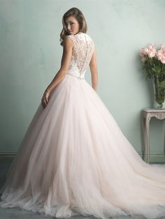 STYLE: 9162 This is truly the ballgown of a princess — a gauzy tulle skirt topped with an incredibly gorgeous lace bodice and a sheer, beaded back.