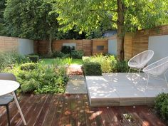 This backyard layout is a bit more doable, but I still don't see #ThisOldHouse having a raised concrete or stone section in the backyard. I also like this image because it starts to think about the privacy fence. Horizontal fencing is in, gang.