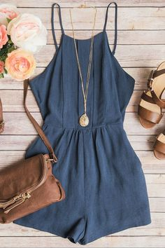 dusty blue romper with keyhole detail in back and paired with cognac colored accessories.