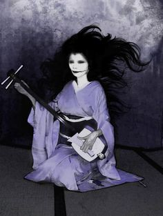"""Kuchisake-Onna (The Slit Mouthed Woman) - Japanese folklore: She was once the very beautiful wife or concubine of a samurai. In a jealous rage, he mutilated her face. Her ghost returned, covering part of her face with a kimono sleeve, asking wanderers """"Do you think I'm beautiful?""""  She would reveal her face with a 'yes' and ask """"Do you think I'm Beautiful now?""""  Various bad things happen with just about any answer. Her modern form seems to wear a 'cold mask'; modern sightings have caused…"""