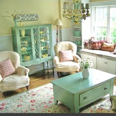 Cottage style living room - like neutrals plus repeated seafoam (although a bit too much seafoam). Need more punch.