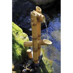 """This Deer Scarer Bamboo Fountain is ideal for use in small ponds or container water gardens. You can also display this lovely bamboo fountain as a disappearing water feature. Dimensions: approx.16"""""""" H"""