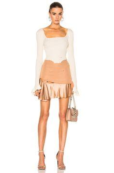 http://www.fwrd.com/product-esteban-cortazar-short-ring-skirt-in-dust-nude/ESTF-WQ1/?d=Womens
