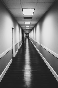 Empty hallway at the end of a long work day.