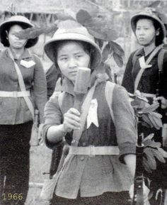 Vietnamese Woman Soldier Hurls Wooden Hand Grenade