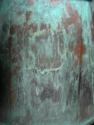 Oxidation on copper that creates beautiful blue-green patinas and patterns.