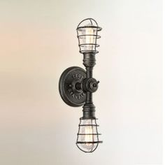 Conduit Wall Sconce features an Old Silver finish with a Cage wrapped around the bulbs. Two 100 watt, 120 volt Edison A Shape type Medium base incandescent bulbs are required, but not included. inch width x 19 inch height x inch depth. Bathroom Vanity Lighting, Wall Sconce Lighting, Wall Sconces, Semi Flush Lighting, Troy Lighting, Industrial Light Fixtures, Industrial Lighting, Industrial Design, Incandescent Bulbs