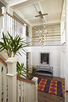 Dramatic entry foyer - look at that stunning glass chandelier eclecticallyvintage.com