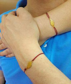 Excelente regalo para los que aman a su pareja. Pulseras con colgantes de oro 18 k. Alas de Ángel, costo del par $239 US