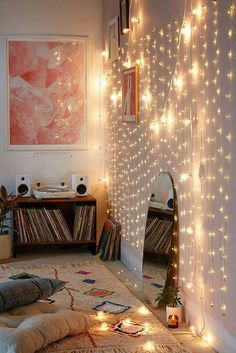 Love the comfy feel of this bedroom. A wall of delicate lights is such a cool idea. These lights are on a 98 ft bendable copper wire! Love these Firefly lights! #fireflylights #bedroomdecor #affiliate