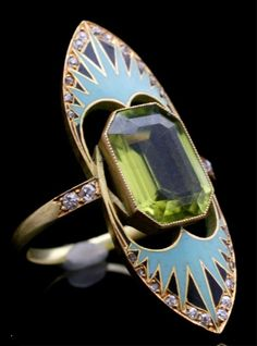 An Art Nouveau ring with Egyptian influence, French, 1900-1910s. Composed of peridot, enamel, Old European- and rose-cut diamonds, and 18K gold.