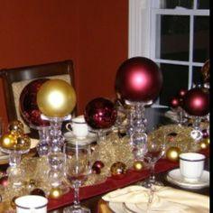 Christmas centerpiece using oversized ornaments & candlesticks