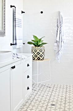 Modern Hamptons bathroom inspiration with gorgeous patterned floor tiles, a classic black and white palette and some graphic modern touches. Totally do-able Hamptons style for your contemporary or coastal home. Ensuite Bathrooms, Bathroom Renos, Budget Bathroom, Bathroom Flooring, Bathroom Interior, Modern Bathroom, Small Bathroom, Master Bathroom, Bathroom Ideas