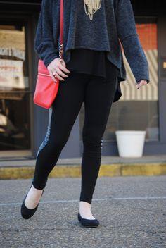 Grey & black oversized sweater top. Leggings with leather detail. Vionic flats. Red Kate spade handbag. Kendra Scott gunmetal necklace. Ray ban aviators.