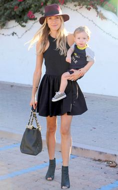 Kristin Cavallari—in a wide-brimmed hat, black dress and booties—holds on to precious cargo (13-month-old son Camden) while out and about in Los Angeles