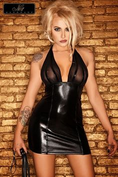 #Femme Cette #robe courte, #fourreau laqué de wetlook d'un noir intense, impose son style avec son top de tulle transparent rayé de fines bandes de #wetlook qui sublime les seins.