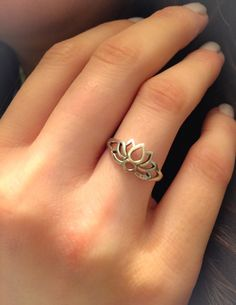 A delicate and beautiful sterling silver open lotus flower ring. Very feminine and delicate. This ring has a 10 mm (0.39 inch) face height. The perfect ring to wear with your other stackables! It also looks so pretty and dainty by itself. The Lotus Flower means purity, hope and new beginnings. The Lotus flower is born into dark murky conditions, literally underwater. Where hope for a beautiful life seems dubious. As the flower grows towards the sun it rises above adversity to be reborn into…