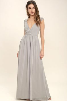 You can feel the magic in the air the moment you slip on the Whimsical Wonder Light Grey Lace Maxi Dress! Lightweight chiffon shapes a pleated surplice bodice with lace straps. Fitted waist leads into a cascading maxi skirt. Hidden back zipper.