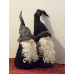 These two best buddies go everywhere together. They are excited about going on a journey to your house next! They would fit in nicely in most any setting where you are hoping for a little whimsy. I need to thank Madeline, a very nice black sheep, for providing me with the lovely black wool. I needle felted each gnome to shape then gave them long beards of silky soft curly locks. The taller of the two is 6.5 inches to the highest bend in his wool hat.
