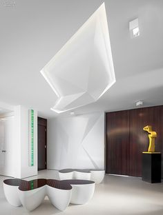 Wall is laser-cut, skim-coated plasterboard to produce facets. Similar angles produced on ceiling. Fiberglass sculpture by Parvis Tanavoli. Exterior Design, Interior And Exterior, Medical Office Design, Interior Design Magazine, Commercial Design, Retail Design, Interior Architecture, Interior Decorating, House Design