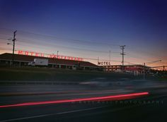 """Week 6: """"Words"""". I have a strong affinity for cheesy Motel signs, especially when they're illuminated at dusk. This one is around the corner from us, and every time I see the sign lit up, I smile inside. I love it's Psycho-feel... It's """"Route 66-ness""""...  SETTINGS: 1/2 second shutter speed on tripod, f/22, ISO 100."""