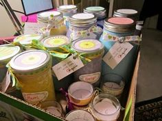 """I made these for """"end of school year"""" gifts.  sprayed mason jars, scrapbook paper tops, ribbon, candy inside."""